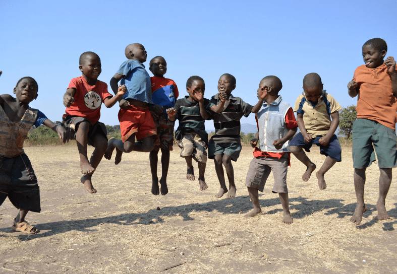 Group of African children jumping in the air