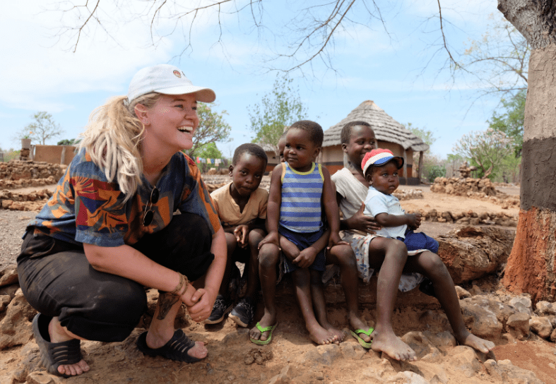 Volunteer with rural children in Zimbabwe
