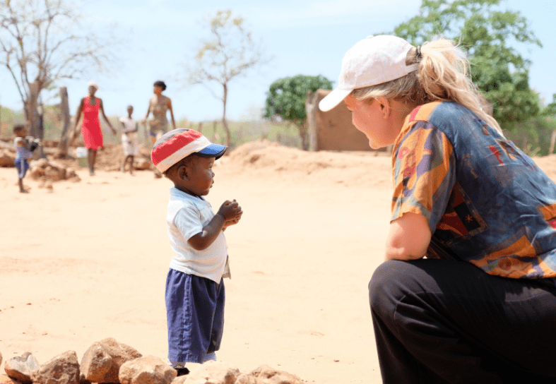 Girl talking to African child