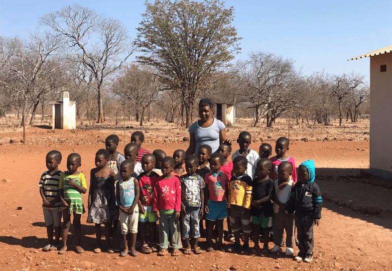 Rural teacher and schoolchildren