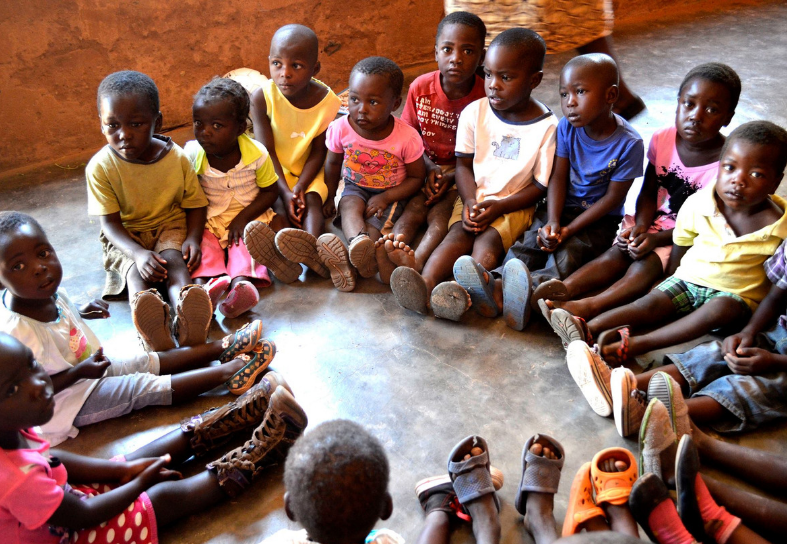 Group of schoolchildren in Africa sitting in a circle