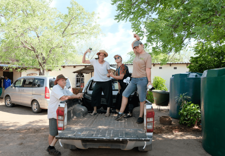 Volunteers and staff on the back of a truck