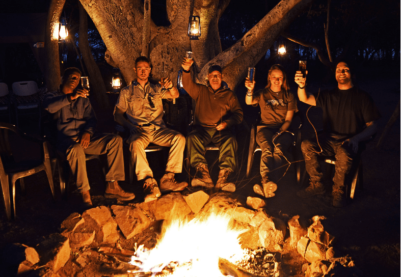 Anti-poaching course students and campfire
