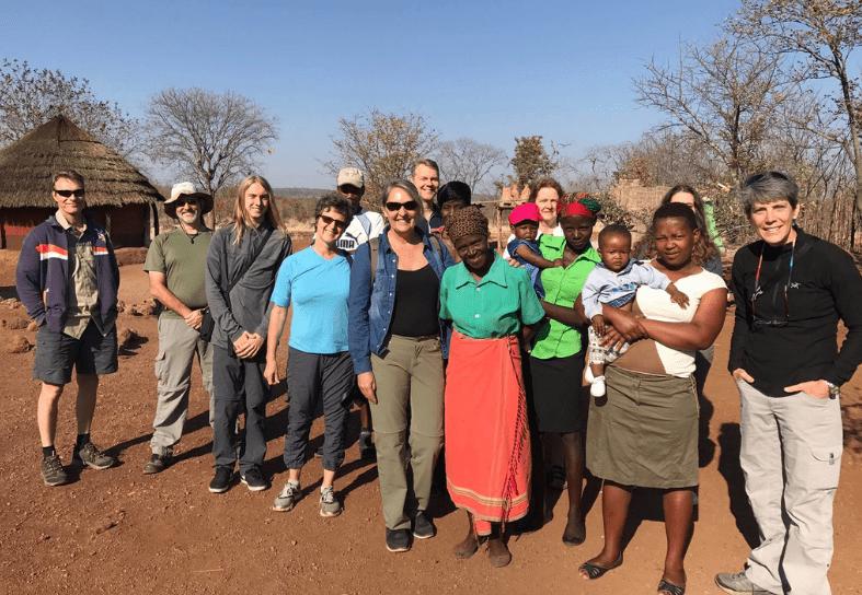 Group of volunteers and ladies in african village