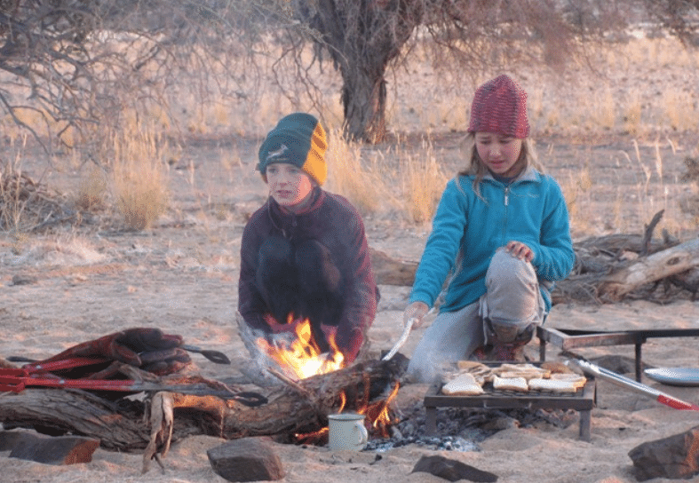 Family-volunteering-campfire-toast