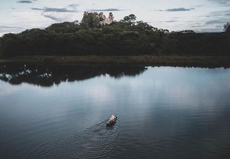 People canoeing across a dam