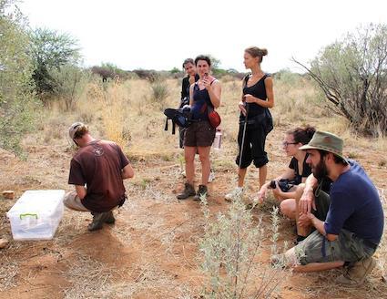 Wildlife sanctuary volunteers learning to track