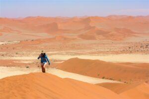 Girl hiking Sossusvlei dunes